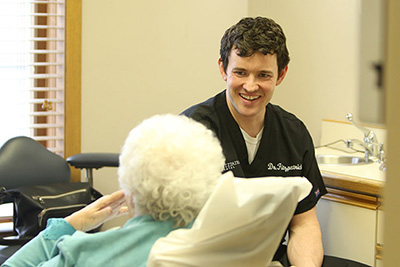 Doctor smiling with older dental patient