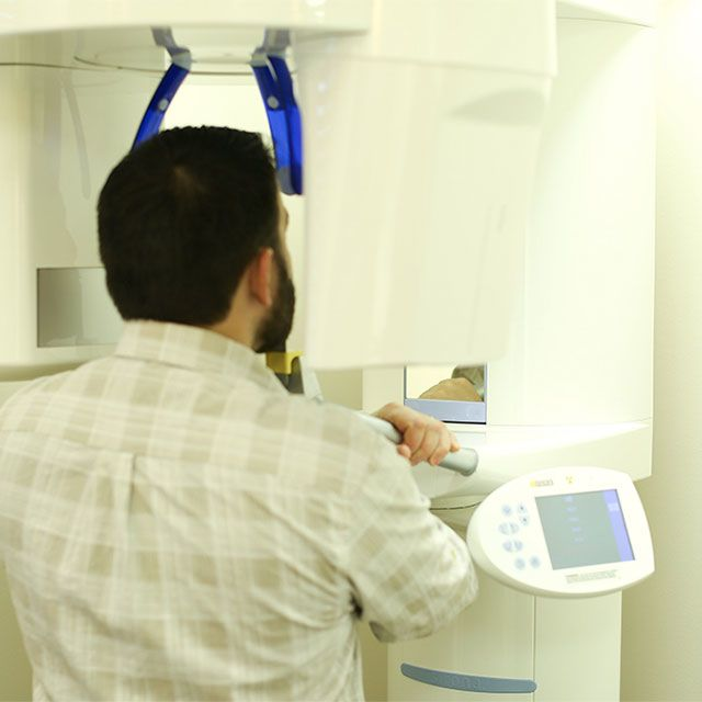 Patient standing in 3D X-Ray machine