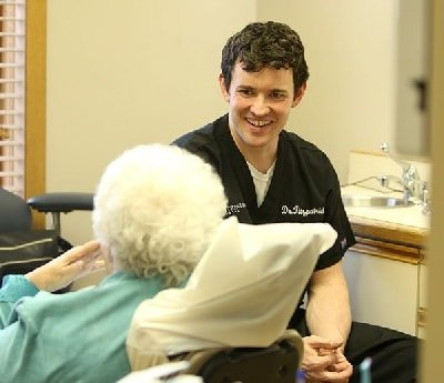 Dr. Fitzpatrick, a dentist in Oak Lawn IL, talking with patient and smiling