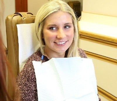Patient smiling in dental chair at a dentist in Oak Lawn IL