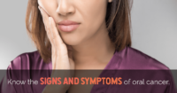 Image of a woman holding her jaw in pain